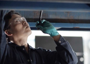"Still photo from ""Just one mechanic"" BCCA Worksafe BC TV commercial"